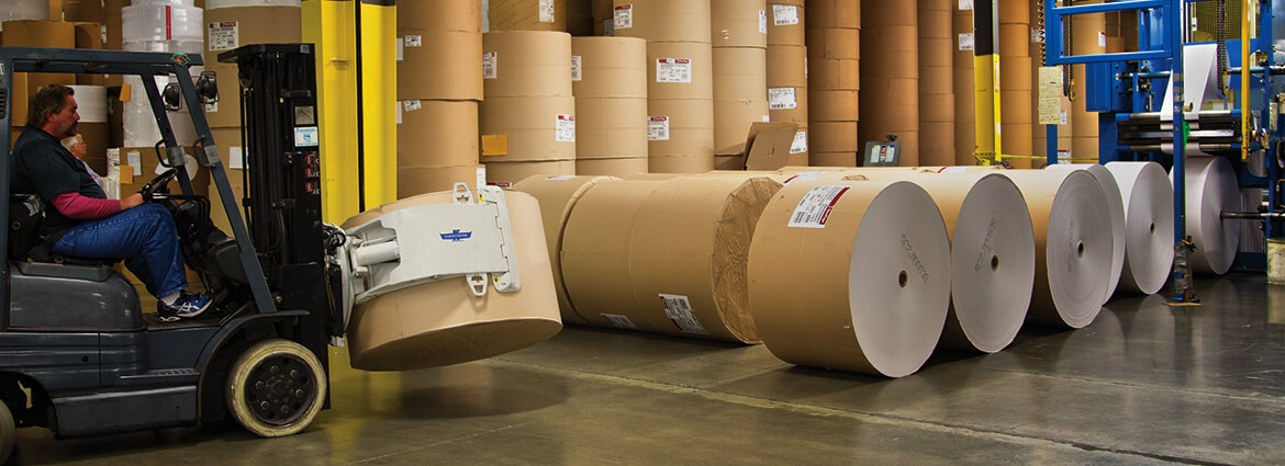 Paper Industry forklift attachment handling rolls.